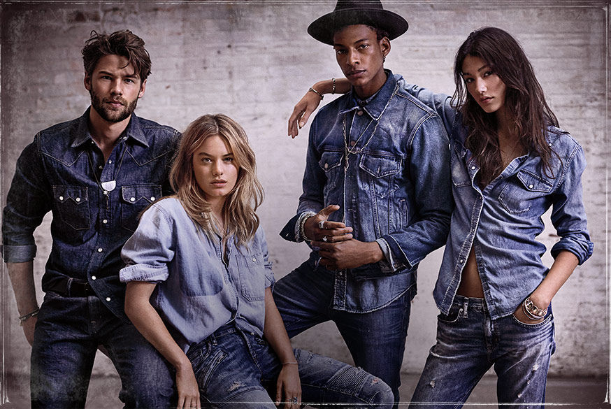 Men & women model chambray shirts & distressed jeans