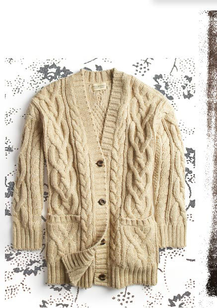 Cream-colored chunky cable-knit cardigan