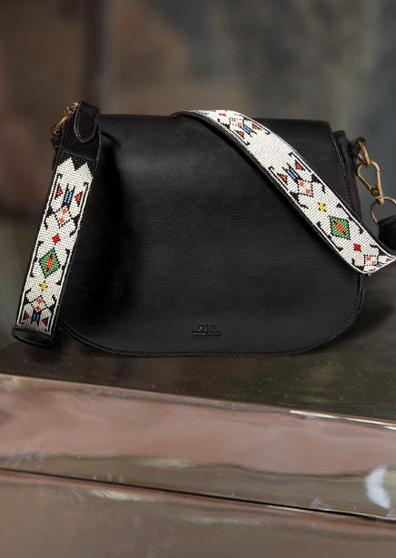Black leather handbag with a contrasting beaded strap