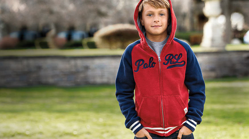 Boy wears red & blue color-blocked zip-up hoodie