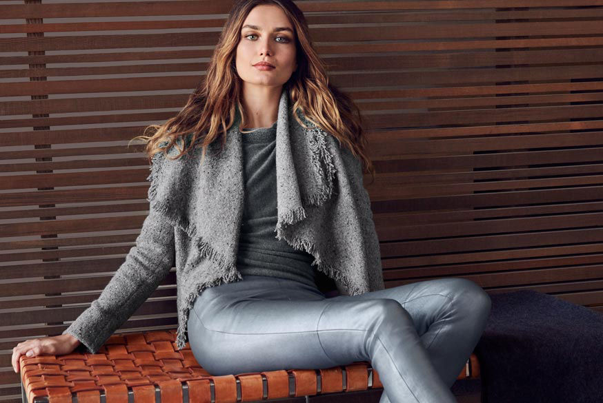 Woman wears grey open-front cardigan with frayed edges with sweater & pant