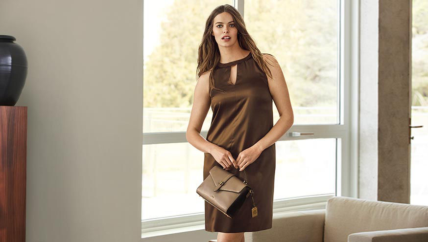 Woman wears brown satin dress with keyhole neckline