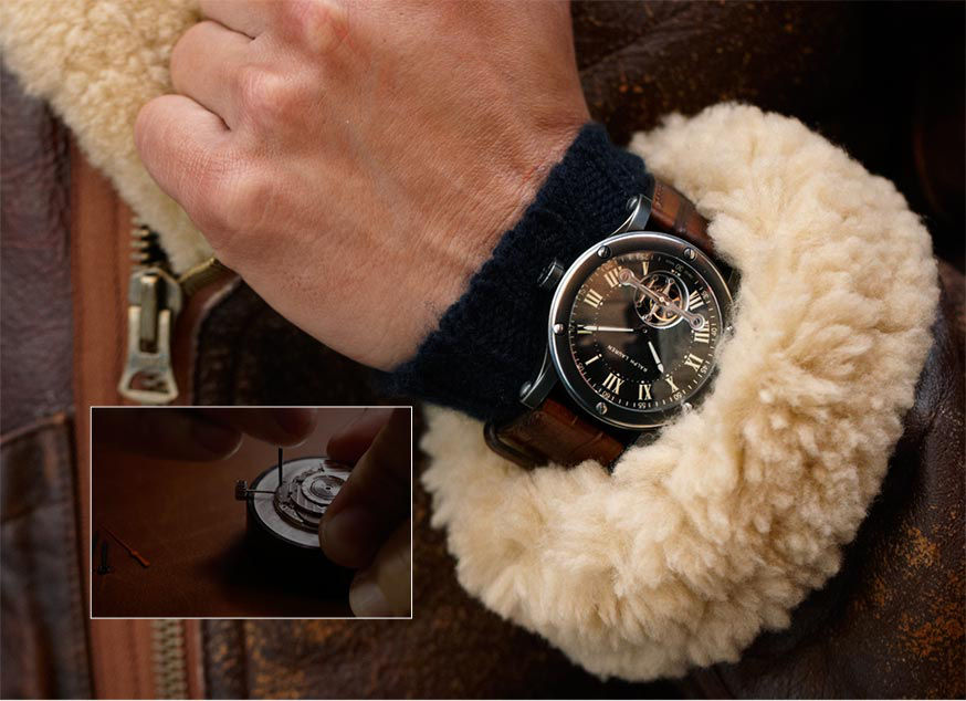 Close up of Safari watch worn with shearling-trimmed leather jacket