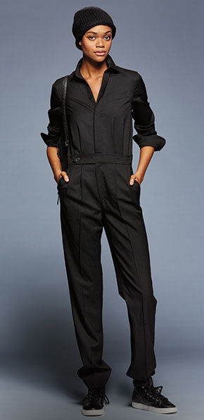 Woman models wool jumpsuit with sleeves pushed up