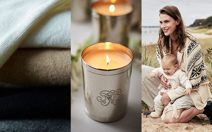 Folded sweaters. 888 Collection Candle. Woman with baby in cream outfits.