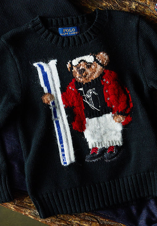 Close-up of sweater knit with a Polo Bear in skiing outfit