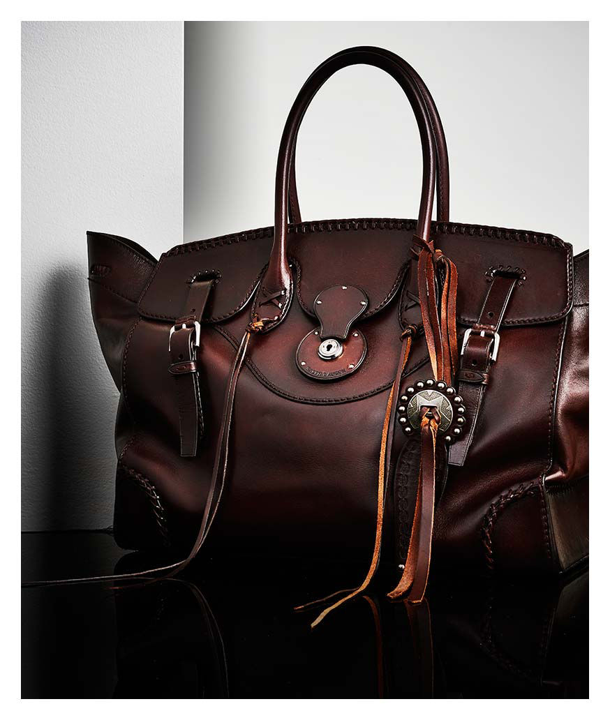 Rich brown leather Ricky Bag with concho accent