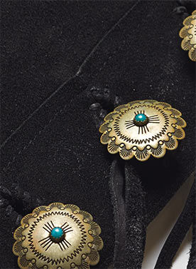 Detail of engraved conchos