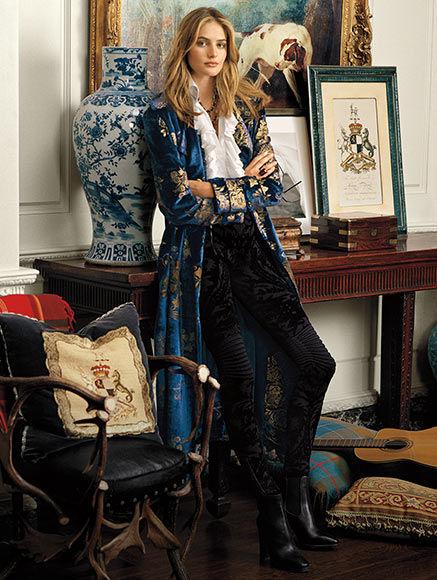 Woman in long printed velvet coat, ruffled blouse \u0026amp; brocade biker legging